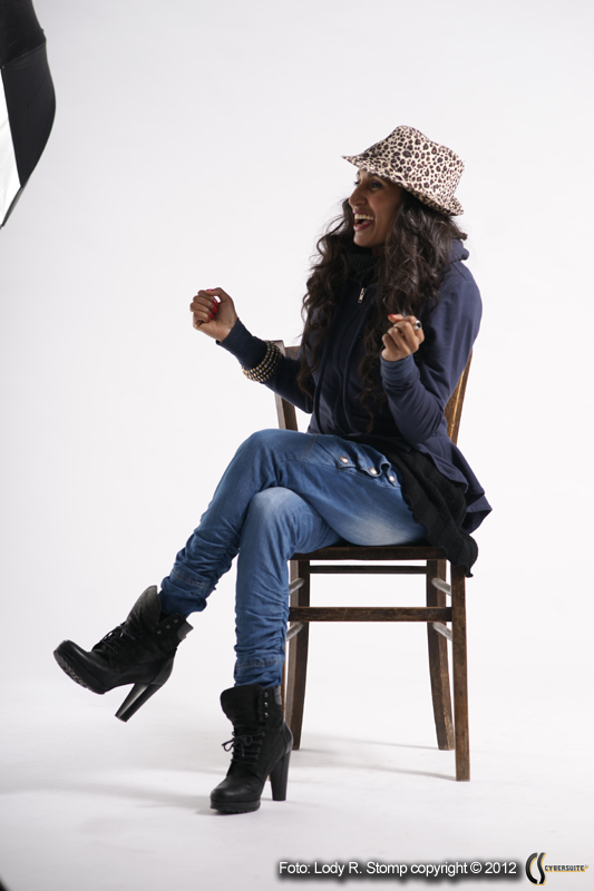 Asha S on chair with hat
